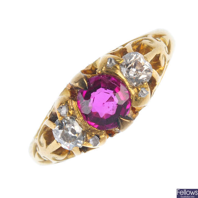 An early 20th century 18ct gold synthetic ruby and diamond three-stone ring.