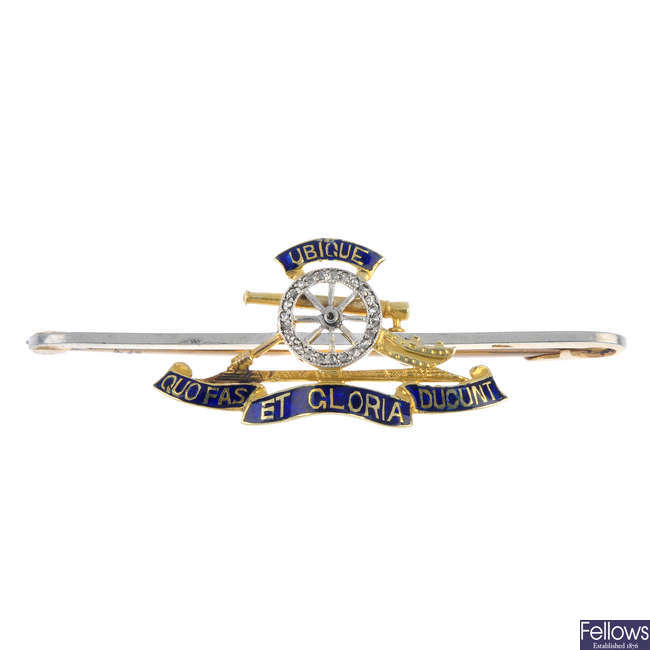 A mid 20th century gold, diamond and enamel Royal Artillery brooch.