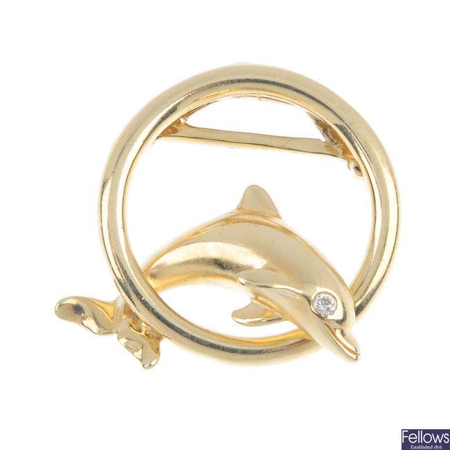 A 14ct gold diamond accent dolphin pendant.