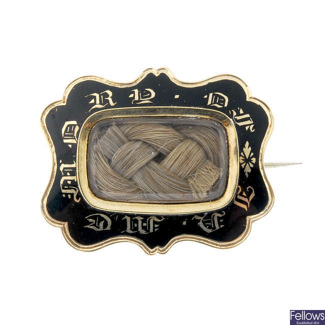A late 19th century gold enamel mourning brooch.