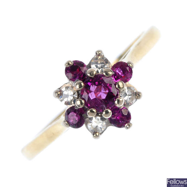 An 18ct gold ruby and diamond floral cluster ring.
