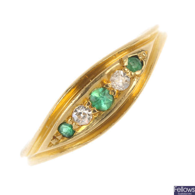 An Edwardian 18ct gold demantoid garnet and diamond ring.