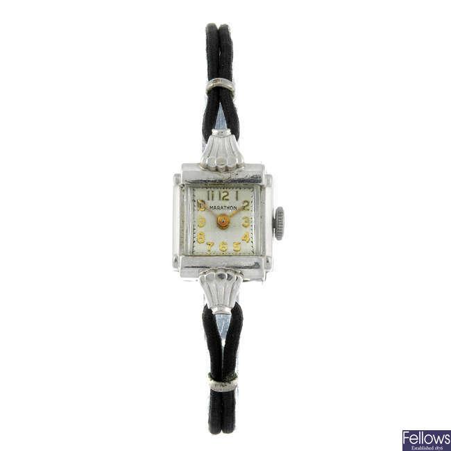 MARATHON - a lady's white metal wrist watch.