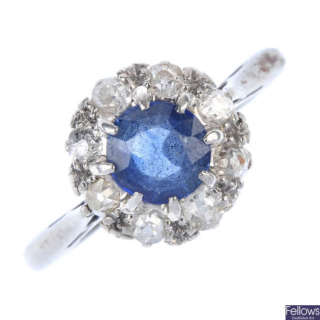 A mid 20th century 18ct gold and platinum sapphire and diamond cluster ring
