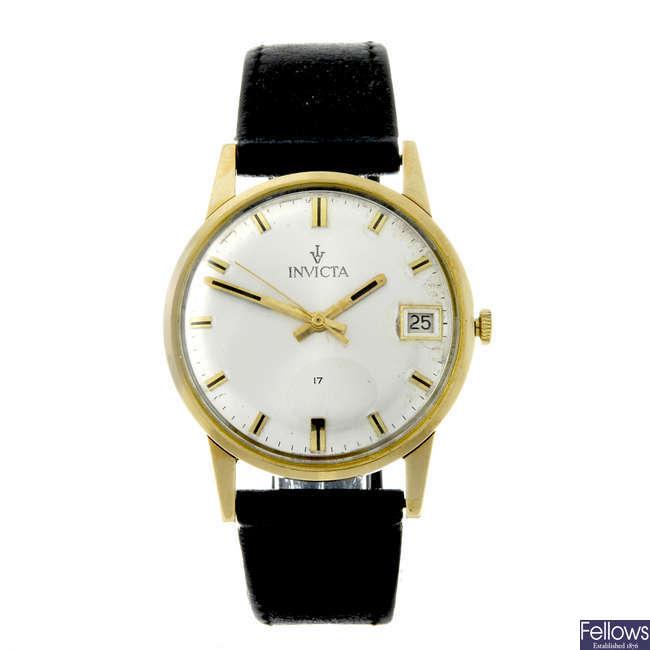 INVICTA - a gentleman's 9ct yellow gold wrist watch.
