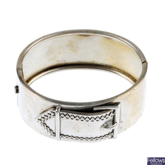 A late 19th century silver hinged bangle, with buckle motif.