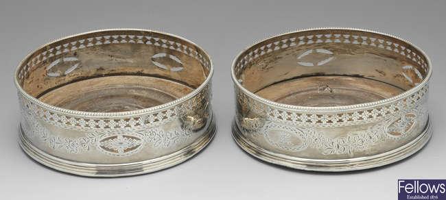A pair of George III silver wine coasters, Samuel Godbehere 1785.