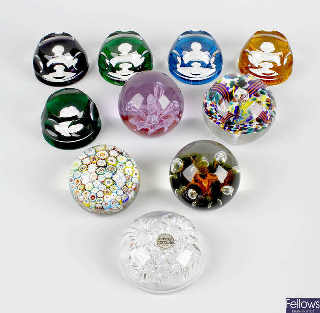 A set of four Franklin Mint Baccarat commemorative glass paperweights.