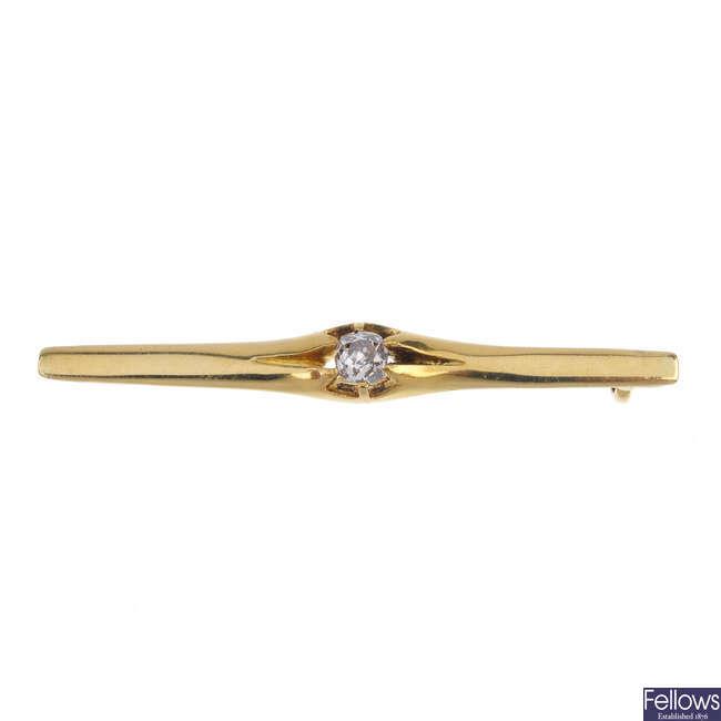 A diamond bar brooch.