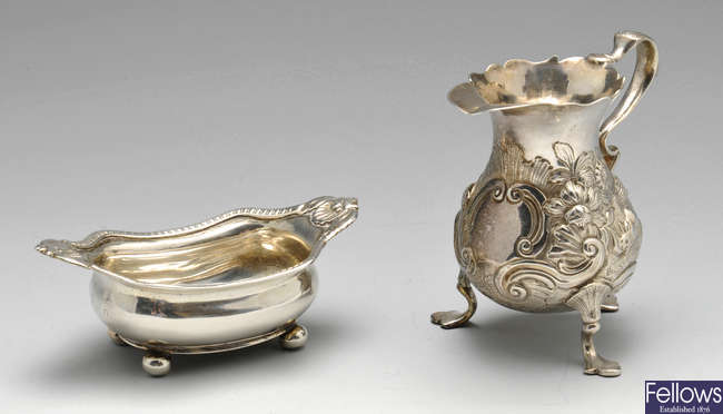 A George II silver cream jug, plus a George III open silver salt.