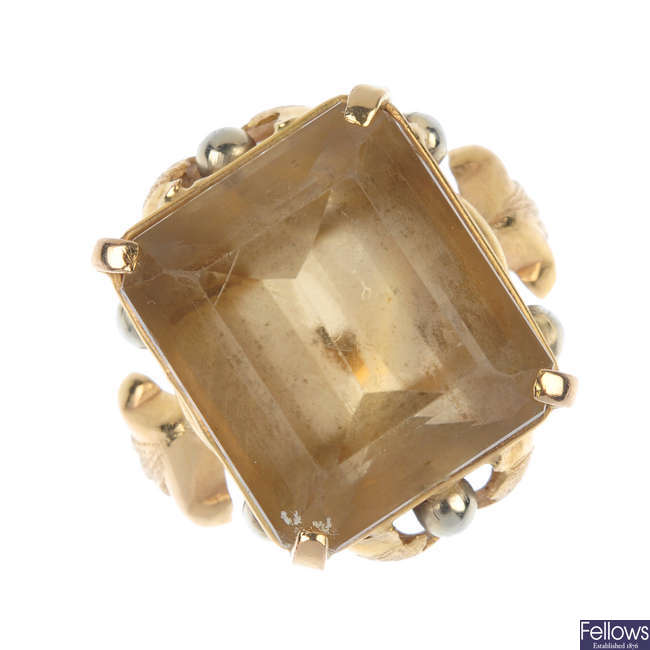 A citrine single-stone ring.