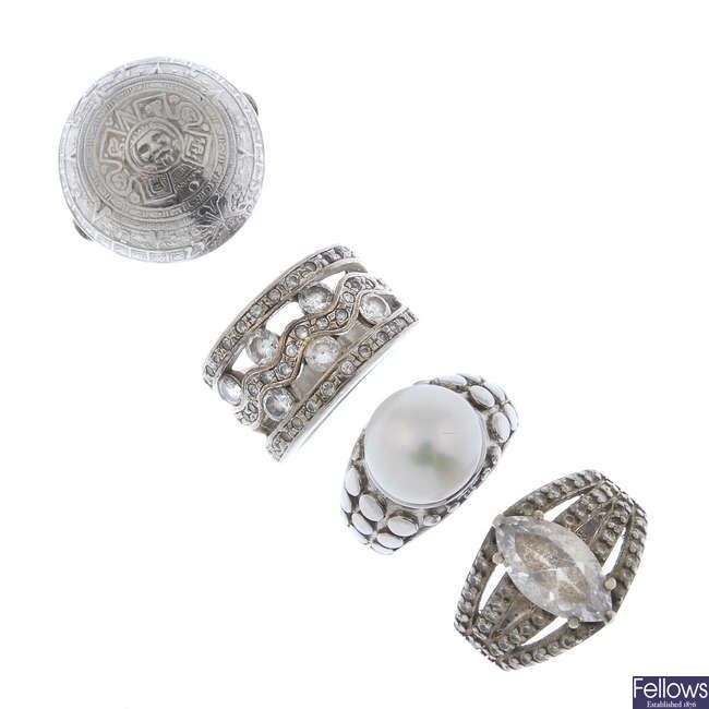 A selection of silver and white metal rings.
