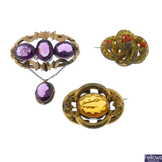 Five mid to late Victorian brooches.