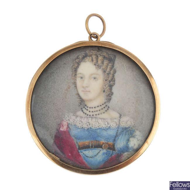 A mid 19th century gold miniature portrait pendant.
