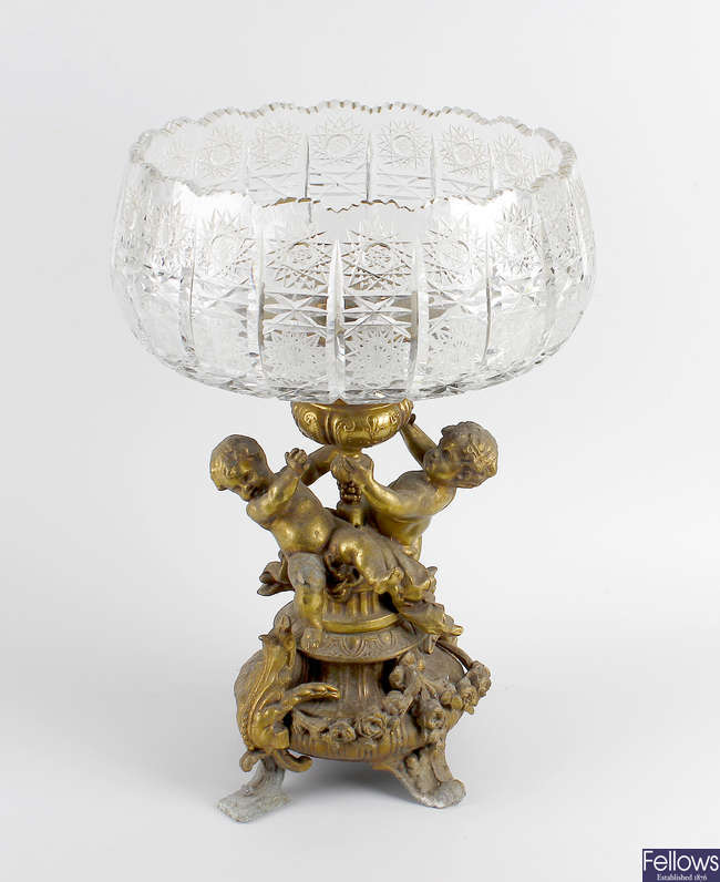 A gilt spelter and cut glass table centre piece.
