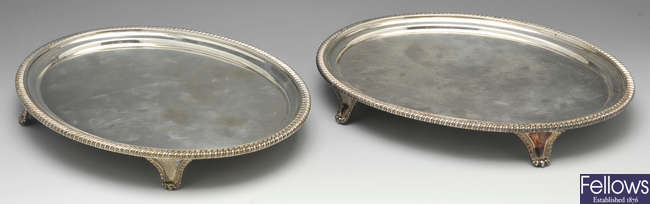 A pair of George III silver oval salvers.