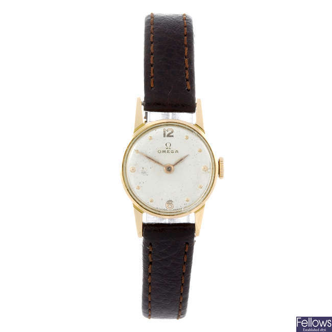 OMEGA - a lady's yellow metal wrist watch.