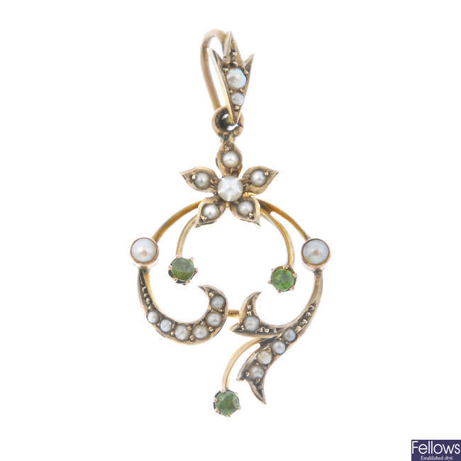 An early 20th century 9ct gold demantoid garnet, seed and split pearl pendant.