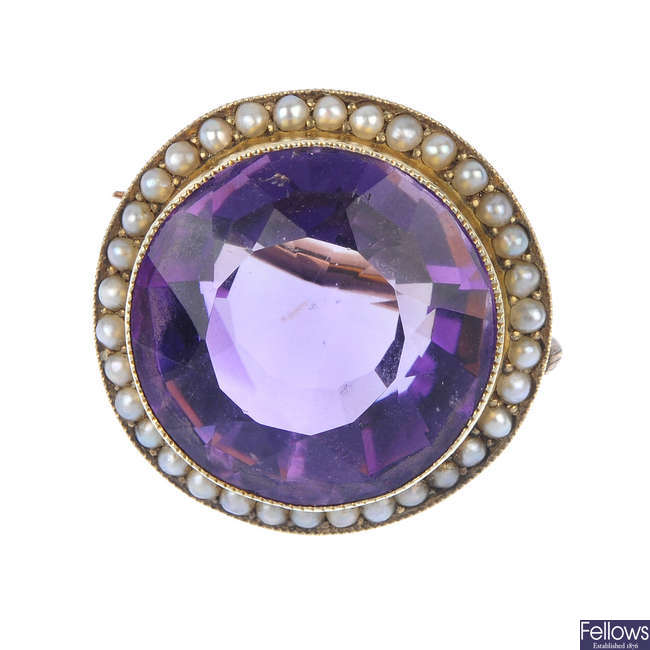 A late 19th century 9ct gold amethyst and split pearl cluster brooch.