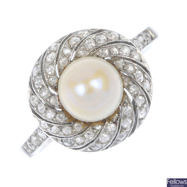An early 20th century platinum pearl and diamond cluster ring.