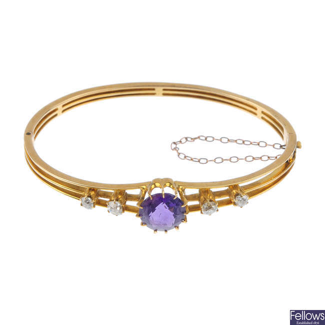 An early 20th century 14ct gold amethyst and diamond hinged bangle.