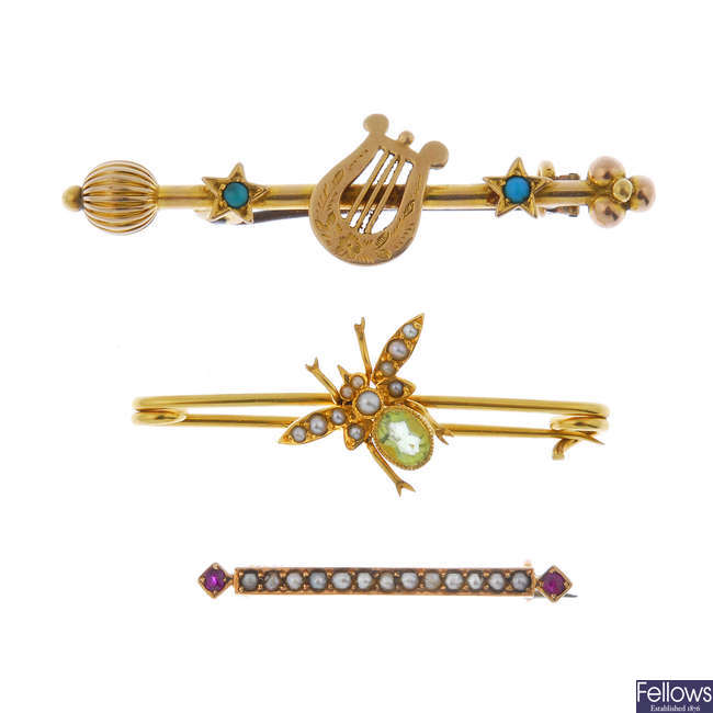 A selection of three bar brooches.