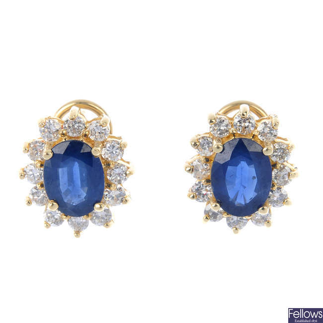 A pair sapphire and diamond cluster ear studs.