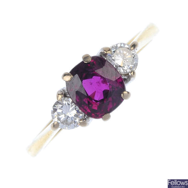 An 18ct gold ruby and diamond three-stone ring.