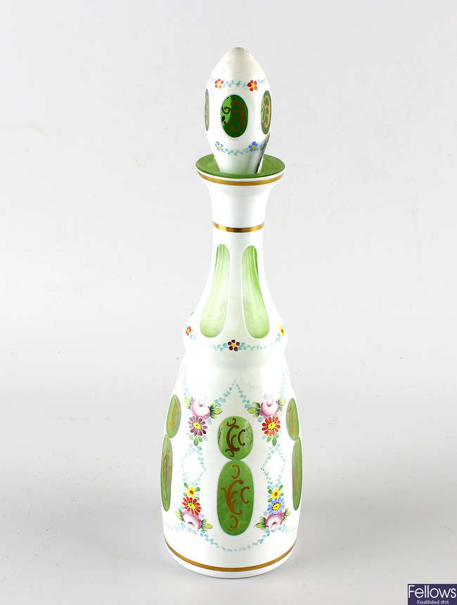 A Bohemian overlay glass bottle and stopper.