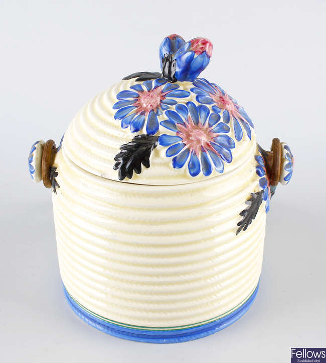 A Clarice Cliff Bizarre beehive pot.