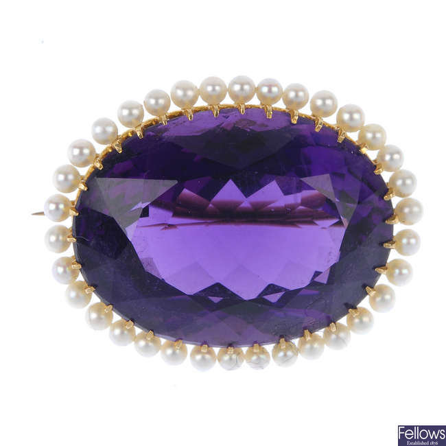 An early 20th century 14ct gold amethyst and seed pearl brooch.