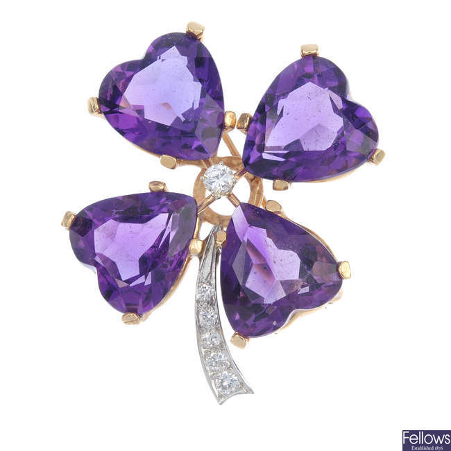An amethyst and diamond four-leaf clover brooch.