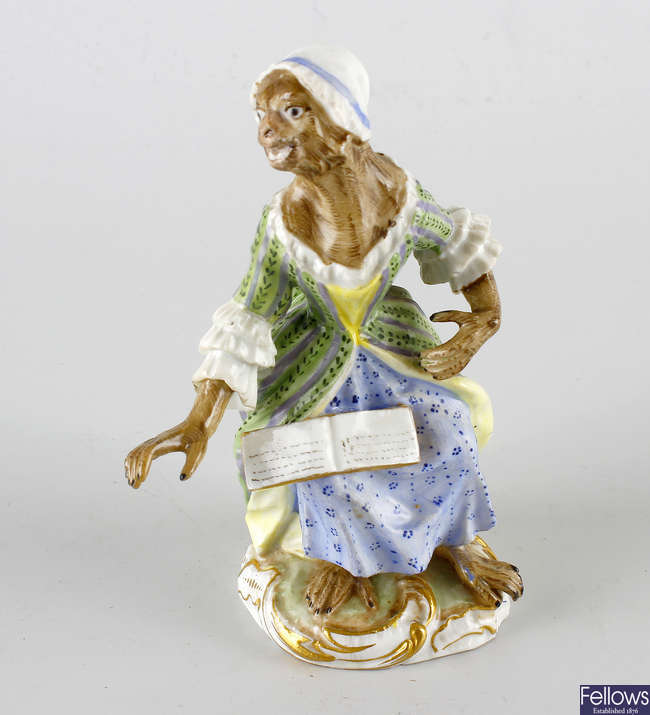 A Meissen monkey band figure.
