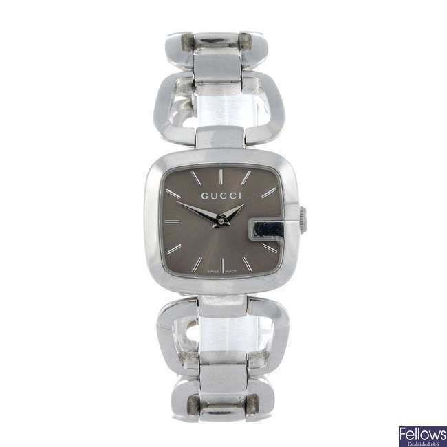 GUCCI - a lady's stainless steel bracelet watch together with another lady's bracelet watch.