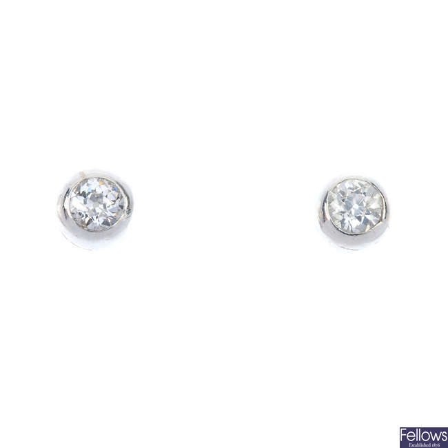 A pair of old-cut diamond collet ear studs.