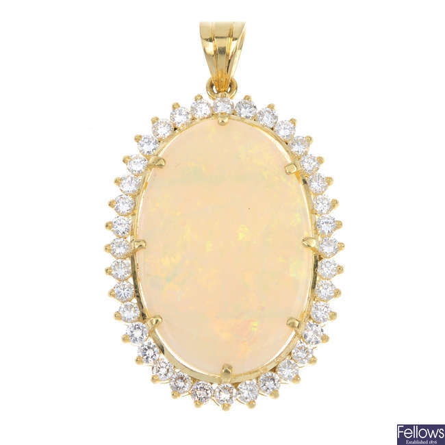 An 18ct gold opal and diamond cluster pendant.