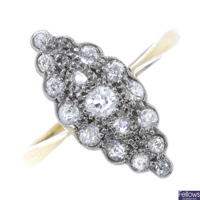 A mid 20th century 18ct gold and platinum diamond cluster ring.