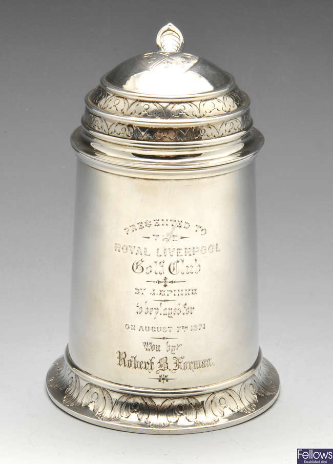 A mid-Victorian silver tankard with golfing crest and inscription.