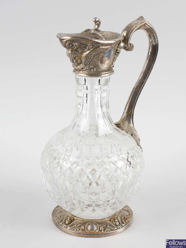 A good quality silver-plated glass claret jug.