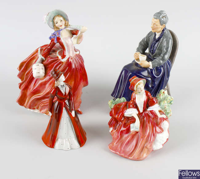 A group of eleven Royal Doulton figures, etc.