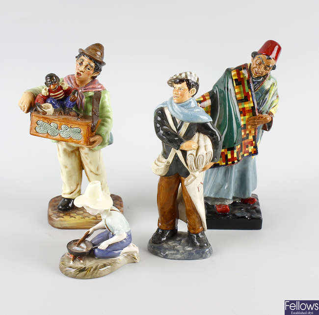 A group of four Royal Doulton figures.