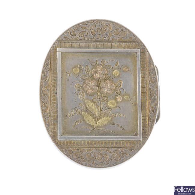 A late Victorian silver locket brooch.