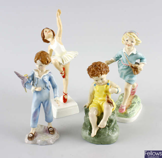 A group of four Royal Worcester figures.