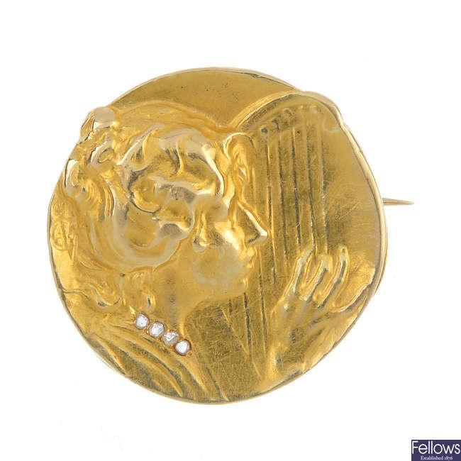 A French Art Nouveau 18ct gold medallist brooch.