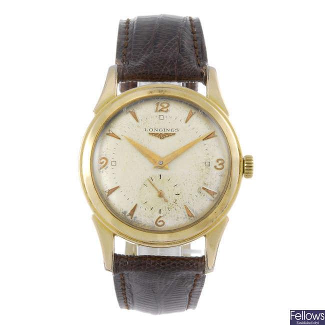 LONGINES - a gentleman's gold plated wrist watch.