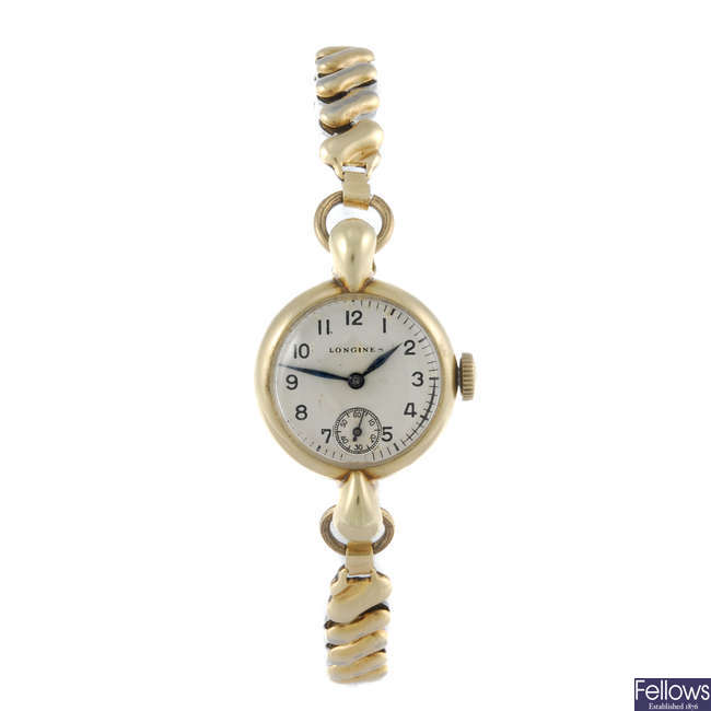 LONGINES - a lady's gold plated bracelet watch.