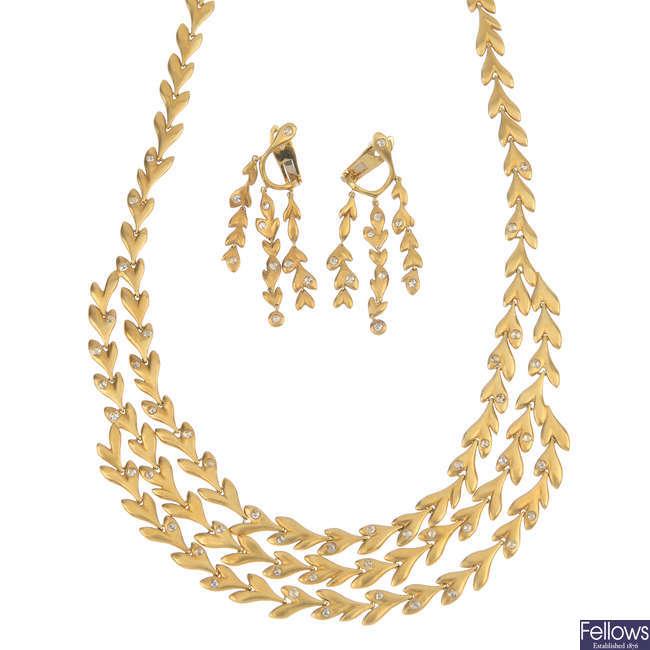A diamond foliate necklace and earring set.