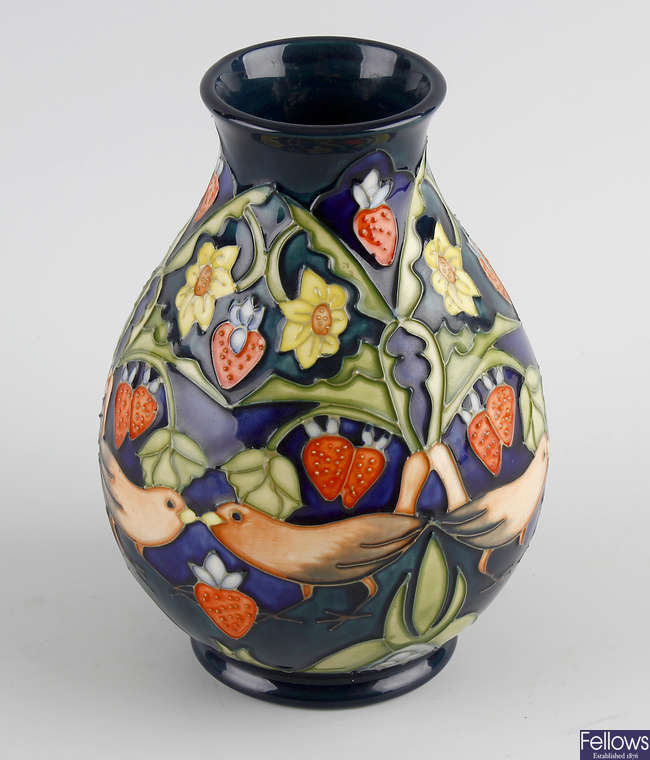 A Moorcroft 'Strawberry Pickers' vase.