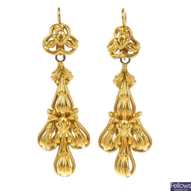 A pair of late 19th century gold ear pendants.