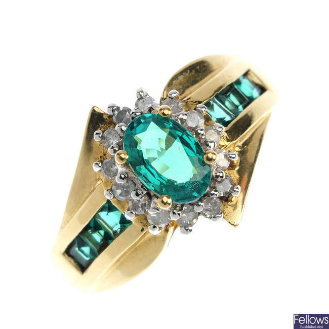 A synthetic emerald and diamond cluster ring.